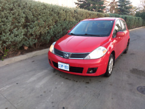 Nissan versa 2008 price negotiable, with safety certificate
