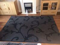 Large black patterned rug