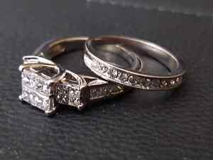 14k White Gold lady's diamond engagement ring and Wedding ring.