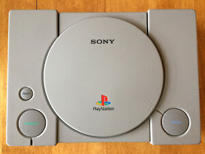 SONY PLAYSTATION with 4 CONTROLLERS, 22 GAMES, 3 MEMORY CARDS