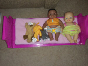 2 dolls. Doll bed and small stuffies