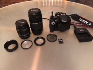 Canon Rebel T2i with 2 lenses, bag, filters and 32GB memory card