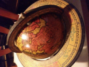 Antique globe with old world map
