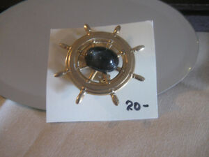 VINTAGE GOLDTONE GEMMED SHIP'S WHEEL BROOCH   ['60's]