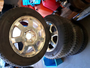 2004 Cadillac cts rims 215 60 16 and winter tires.