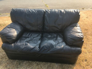 Leather love seat- reduced