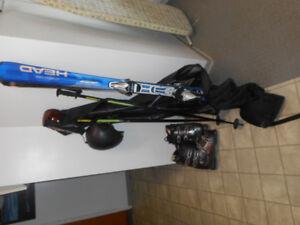 Skis boots poles helmet bag goggles