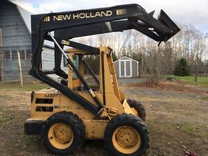 New Holland L-555 (Deluxe) Slid Steer w Attachments UPDATED
