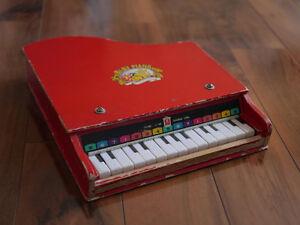 15 key 'Baby Piano' made in SHANGHAI CHINA.