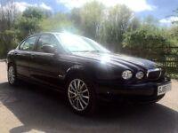 Jaguar X-type 2.0 diesel black with beige interior