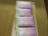 4 habitat cushions. Satin type fabric.