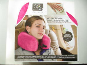 Memory foam travel pillow in pink