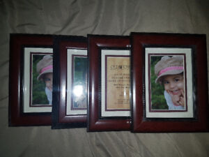 4 wood picture frames for 4 by 6 or 5 by 8 pictures.