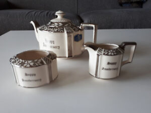 vintage silver luster teapot and creamer and sugar bowl