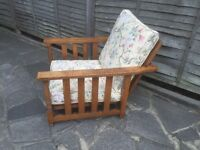 Vintage solid oak chair which turns into a bed
