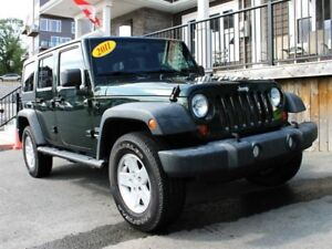 2011 Jeep Wrangler Unlimited Sport / 3.8L V6 / 6 spd / 4x4