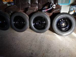 215 70R 16 Altimax Artic studed winter tires. In great shape.