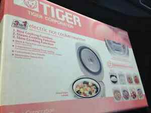 Brand new Tiger cooker(rice cooker/slow cooker/steam)