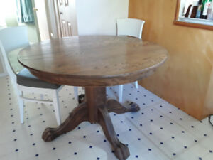 Solid oak dining table with two leaves