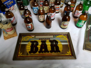 Vintage stubby beer bottles and bar signs