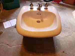 American standard sink and wooden pedestal