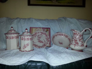 Red toile canisters, jug, basin and plate set