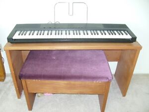 Digital Korg Piano with stand and seat with storage.