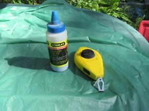 CHALK LINE AND BOTTLE OF CHALK