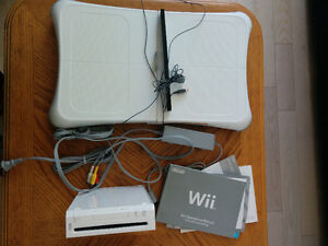 Wii console + wii fit board+ Wii sports/play+ others!!