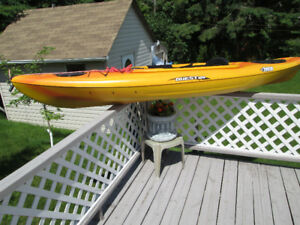 Pelican Kayaks, tri hull type.Very stable in the water. 10' long