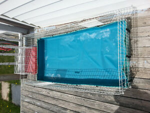 Large guinea pig cage with accessories and small hamster cage