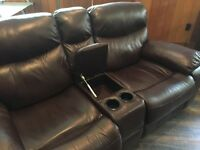 Reclining, leather love seat