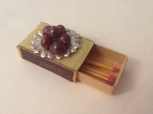 Vintage match box with glass beads