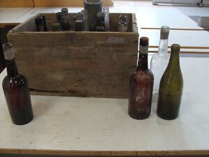 Whiskey crate filled with antique bottles