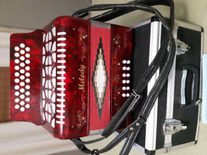 A button accordian for sale