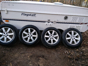 Four Nissan mags with tires