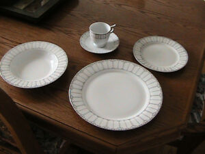 12 place setting dinnerware set with extras.