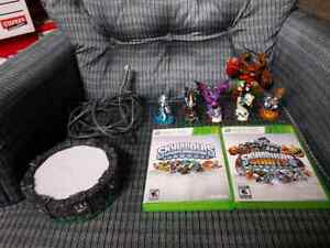 2 skylanders games for Xbox 360 with some characters & portal