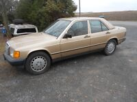 2 mercedes 190D with lots of parts and  2 sets  new tires all