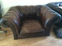 Brown leather Chesterfield type chair