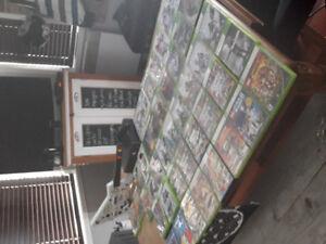 X box 360..45 jeux ..la guitare  ( guitare hero) pas de manette