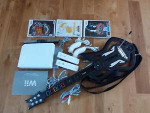 Console WII avec accessoires et 3 jeux+ guitare