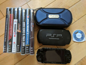 Sony PSP with 8 games, case, games case