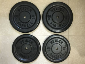 Weider iron weight plates / poids en fonte 2x50 lbs and 2x35 lbs
