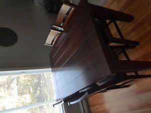 Ashley counter height table w/extension and 4 chairs