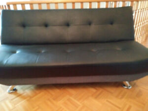 Black sofa bed never used.