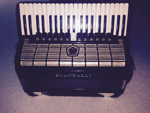 Excellent four chamber Scandalli full size accordion