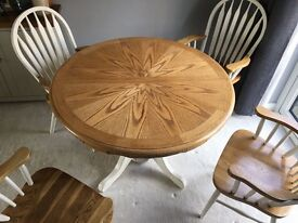 Solid oak extending round dining table 4 carver chairs