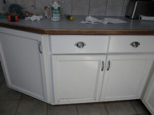 """L"" shaped white shaker lower kitchen cabinets"