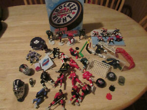 Hockey figurines and other assorted NHL toys & hockey DVD game.